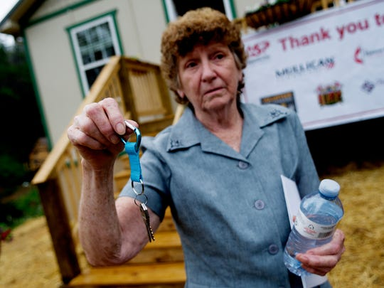 Glenna Ogle holds the keys to her new home during the