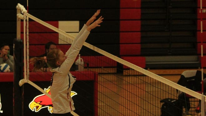Junior middle hitter Rachel Dahlen makes a block in a game against Fargo South Oct. 15 at Devils Lake High School. The Firebirds lost 3-0