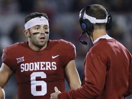 Oklahoma coach Lincoln Riley, right, talks with quarterback Baker Mayfield on Nov. 11 during the TCU game.