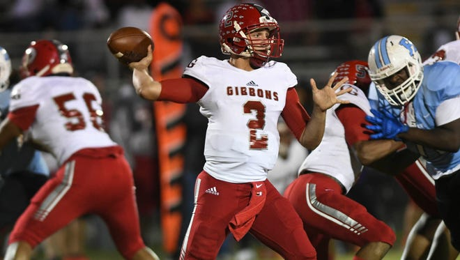 Cardinal Gibbons QB Nik Scalzo passes the ball during Friday's game vs. Rockledge.