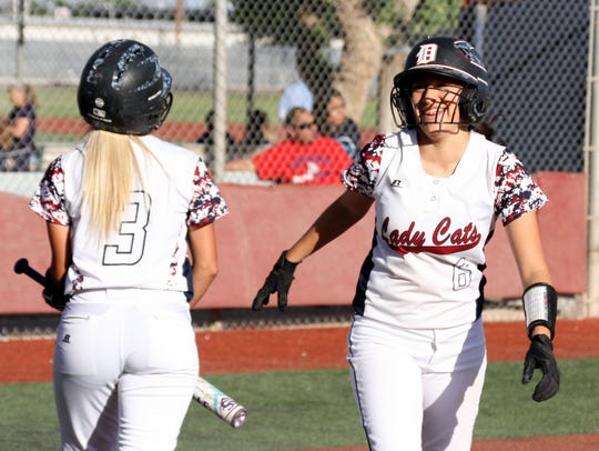 Lady Cat sophomore Evelyn Ramirez, right, is all smiles