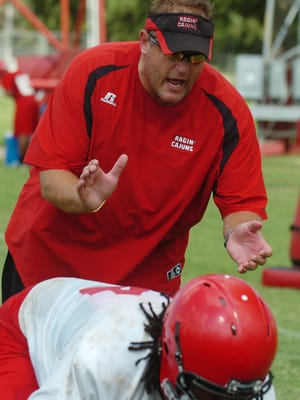 Former UL defensive coordinator Kevin Fouquier encourages his players during a practice session back in 2009.