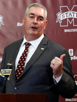 New Mississippi State football coach Joe Moorhead explains what he will be looking for in an assistant coach to reporters and team supporters at his official introduction by the university, Thursday, Nov. 30, 2017, in Starkville, Miss. (AP Photo/Rogelio V. Solis)