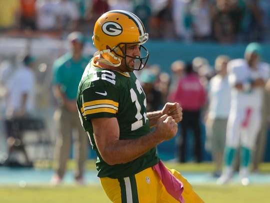 Packers quarterback Aaron Rodgers celebrates after throwing the game winning-touchdown in the closing seconds against the Miami Dolphins.