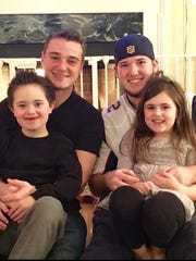 Luca Zadeh pictured with his three siblings: two older brothers Ryan Ellis (left), Eric Ellis (right) and little sister Zoe Zadeh (bottom right)