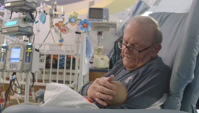 'ICU Grandpa' sings 'You Are My Sunshine' to a baby at Children's Healthcare of Atlanta.