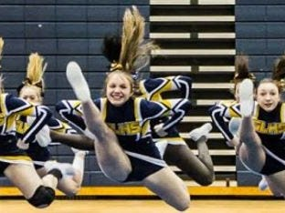 Grand Ledge's competitive cheer team established new records in two events in February.