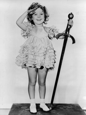 """FILE - In this 1933 file photo, child actress Shirley Temple is seen in her role as """"Little Miss Marker"""". Shirley Temple, the curly-haired child star who put smiles on the faces of Depression-era moviegoers, has died. She was 85. (AP Photo/File) ORG XMIT: TOK305"""