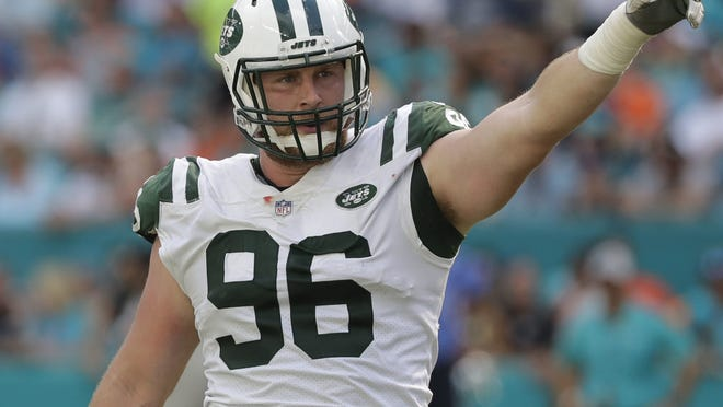 New York Jets defensive end Henry Anderson (96) gestures, during the first half of an NFL football game against the Miami Dolphins, Sunday, Nov. 4, 2018, in Miami Gardens, Fla. (AP Photo/Lynne Sladky) ORG XMIT: OTK
