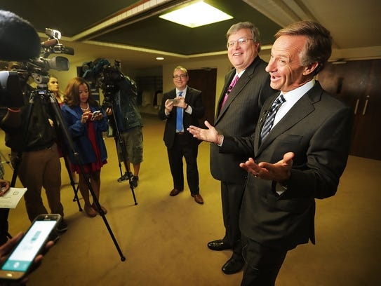 Gov. Bill Haslam (right) jokes with the media during