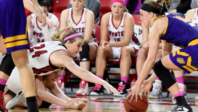 University of South Dakota's Ciara Duffy loses control of the ball to Western Illinois' Mallory Boyle during their game at Sanford Coyote Sports Center in Vermillion on Saturday, Jan. 28, 2017.