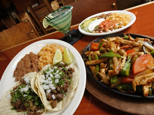 The Grilled Steak Taco lunch special, left, Chicken Fajita plate, right, and a hand-crafted margarita at Taqueria Mercado.