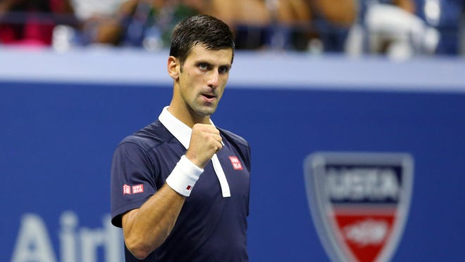 Novak Djokovic of Serbia celebrates after defeating Feliciano Lopez of Spain on day nine of the 2015 U.S. Open tennis tournament at USTA Billie Jean King National Tennis Center.