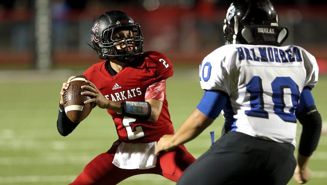 Garden City's Trent McMillan prepares to throw a pass last season against Balmorhea. Garden City checks in at No. 4 in this week's six-man rankings, while Balmorhea is No. 1.