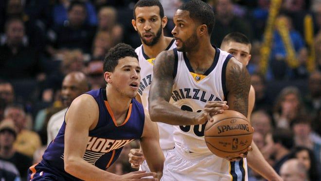 Feb 8, 2017: Memphis Grizzlies guard Troy Daniels (30) handles the ball against Phoenix Suns guard Devin Booker (1) during the first half at FedExForum.