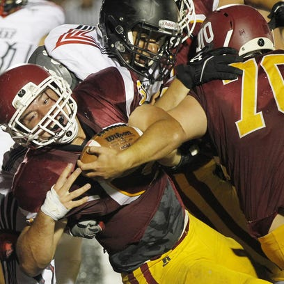McCutcheon's A.J. Andrews lunges over the goal line