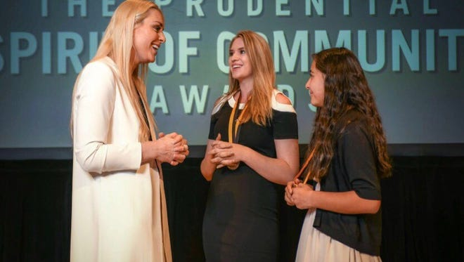 Piedra Vista High School senior Trennery Turner, center, and Albuquerque fifth-grader Lily Chacon speak with Olympian Lindsey Vonn at the Prudential Spirit of Community Awards Ceremony in Washington, D.C., on April 29.