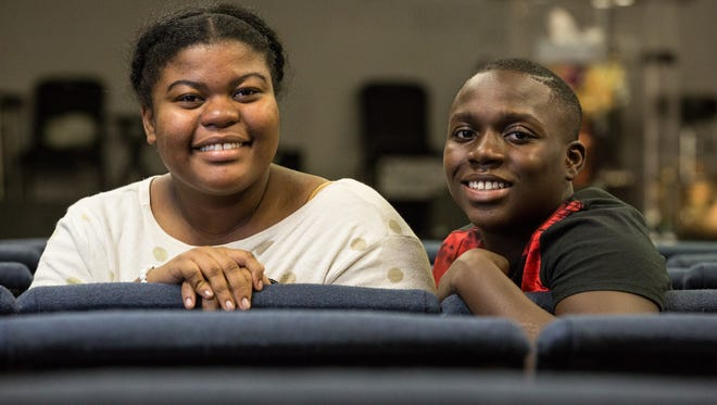 Leyna Paul, 16, and Junior Desty, 14, pose for a photo at the Word of Life Center on Jersey Road on Thursday, Dec. 7, 2017.