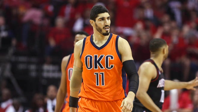 Oklahoma City Thunder center Enes Kanter (11) reacts after a play in game one of the first round of the 2017 NBA Playoffs against the Houston Rockets at Toyota Center.