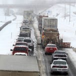 Cars and trucks idle on southbound Interstate 25 just south of Highway 34 at the Loveland, Colorado exit Satuday Marchc 23, 2013 following a multi car wreck.