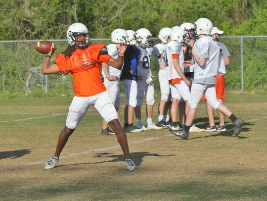 Blackman junior Adonis Otey fires a pass during the first day of spring practice Monday. Otey is the frontrunner to be the team's quarterback in 2018.