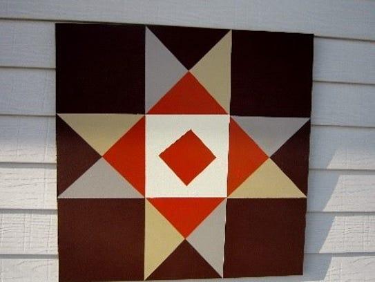 Marilyn Salzl Brinkman's barn quilt on the garage.