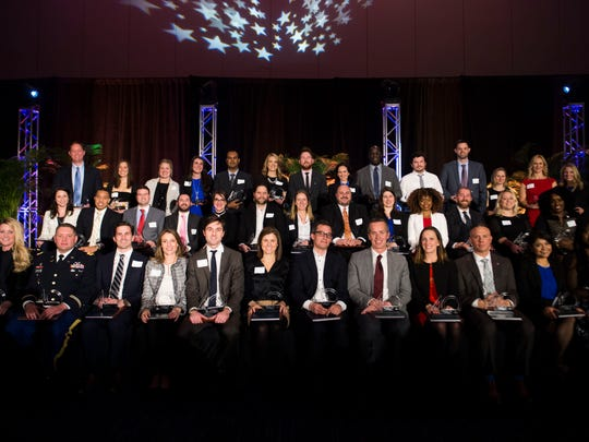 The 2017 class of 40 under 40 pose for a photo at the