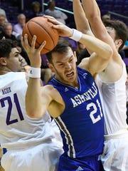 UNC Asheville's Giacomo Zilli (21) splits a pair of Furman defenders.