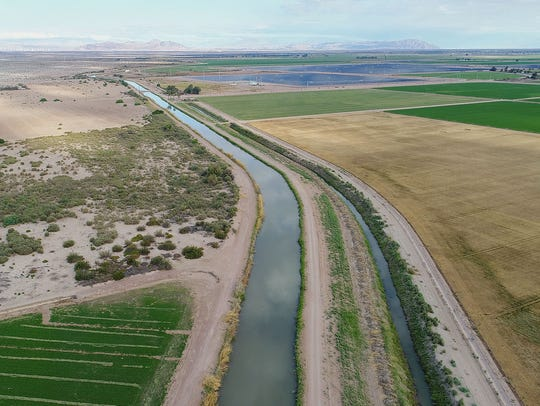 The Westside Main Canal flows past farmland owned by