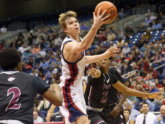 Veterans Memorial's Will Chayer readers for the ball against Mansfield Timberview during the Class 5A state semifinal on Thursday, March 9, 2017, at the Alamodome in San Antonio.