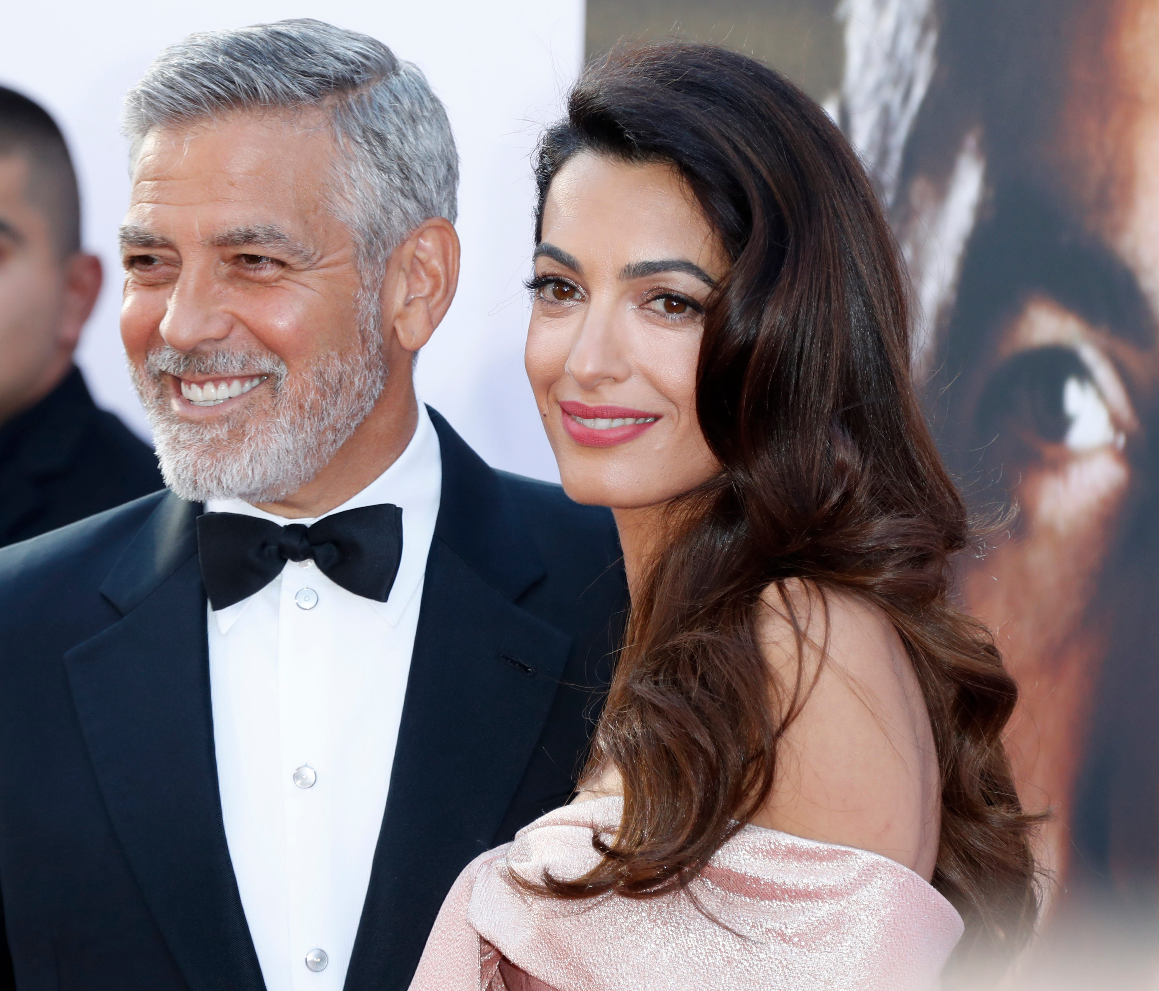 epa06792472 US actor George Clooney (L) and his wife Amal Clooney (R) arrive for the American Film Institute 46th Life Achievement Award Gala at the The Dolby Theatre in Hollywood, California, USA, 07 June 2018. The American Film Institute honored Ge