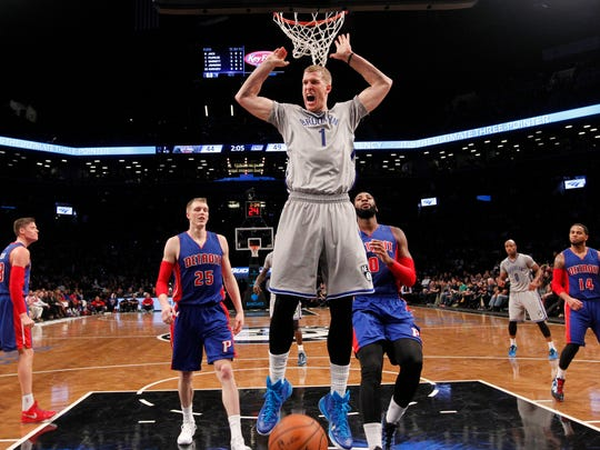 Brooklyn Nets center Mason Plumlee (1) reacts after scoring ahead of Detroit Pistons forward Kyle Singer (25) and center Andre Drummond (0) during the second quarter of Sunday's game.