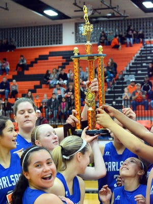Carlsbad celebrates winning its second straight City of Champions Classic title Saturday at Artesia.