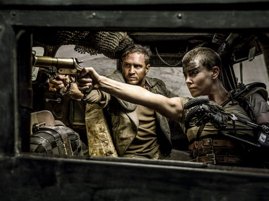 Tom Hardy and Charlize Theron appear in a scene from