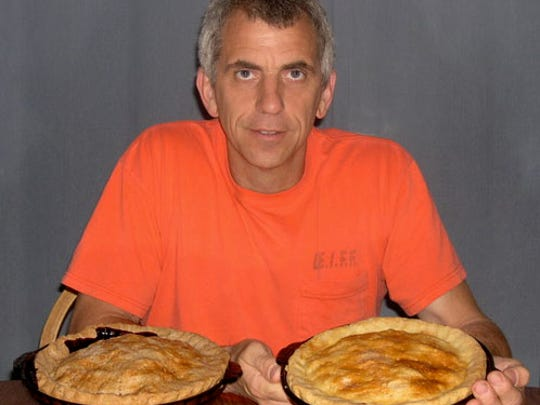 Joe Schwark, shown with blackberry pies, learned the art of pie            making from his mother, Evelyn Ramczyk-Schwark.