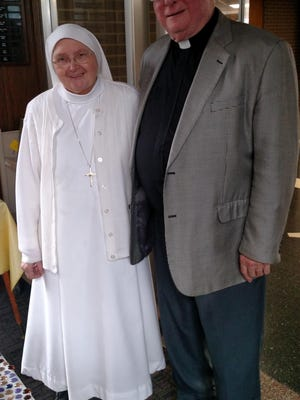 Sister Jean Marie Squiric is the new campus minister at St. Thomas Aquinas Middle School and High School. She's pictured with the Rev. Thomas Dyer, retired president of St. Thomas Aquinas High School.