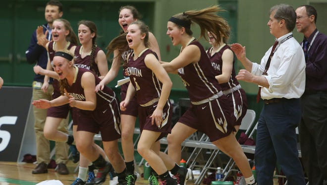 Pittsford Mendon players  and coaches Todd Julien and Jim Talbott celebrate their 53-41 victory over Somers n Friday's Class A girls basketball  state semifinals at Hudson Valley Community College in Troy.