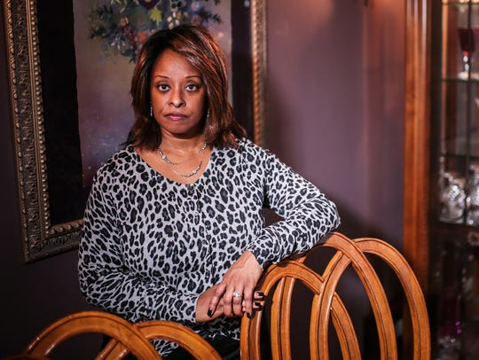 Cecile Taylor, 52, of Canton, is photographed at home