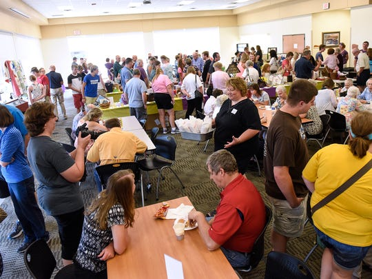 People take part in several activities during a benefit event for April Myers Sunday at the Sauk Rapids Government Center Community Room.