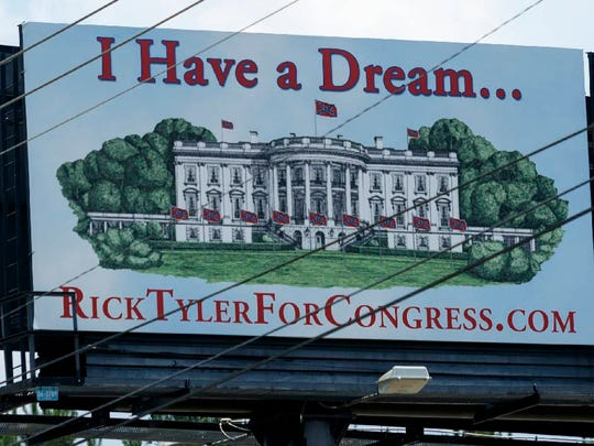 """A campaign sign for congressional candidate Rick Tyler that features Confederate flags surrounding the White House is seen on Highway 64 on Wednesday, June 22, 2016, in Polk County, Tenn. Tyler also posted a billboard sign that read """"Make America White Again"""" on Highway 411 near Benton, Tenn."""