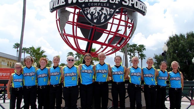 From left to right; Team Mojo's Lexie Lockwood, Tamra Elliott, Lexi Scott, Olivia Smith, Avery Miller, Gracey McCullough, Carissa Wheeler, Kerrigan Ward, Abby Hammond, Amber Hice, Kaitlin Potts and Caelan Miner are shown in front of ESPN's Wide World of Sports Complex during a recent tournament trip to Florida. Not pictured is Abbi Stanforth.