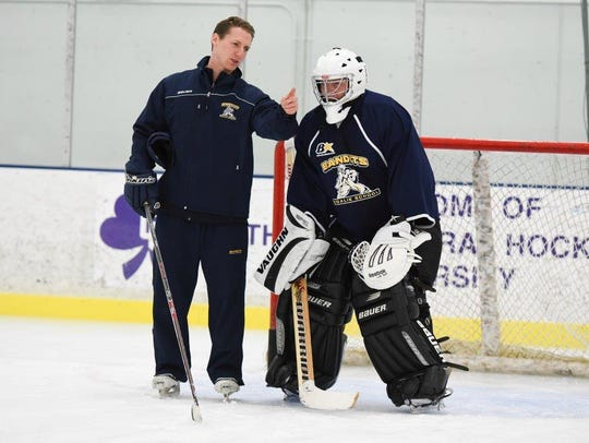Explaining a five-shot drill to goalie Tim Smith is