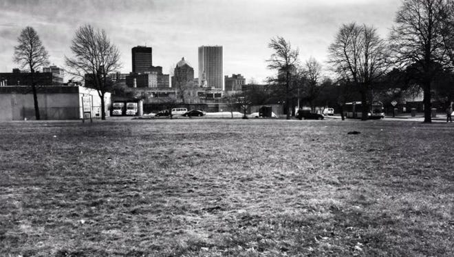 Downtown Rochester is seen in the distance from the empty lot at the corner of Joseph Avenue and Nassau Street in the neighborhood where the July 1964 riots erupted.
