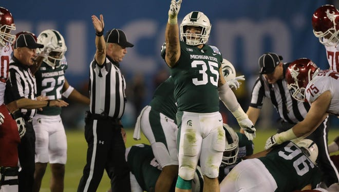 Linebacker Joe Bachie celebrates a fumble by the Cougars during the third quarter of the Holiday Bowl.