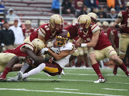 Boston College defenders, from left,Lukas Denis, Kevin