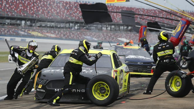 Ryan Blaney gets service in the pits on his way to victory in the NASCAR Cup Series race Monday at Talladega Superspeedway.