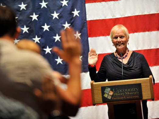 U.S. Citizenship and Immigration Services (USCIS) Regional Director, Kathy Redman administers the Oath of Allegiance to AmericaÕs newest citizens during a special naturalization ceremony at the Upcountry Museum on Thursday, July 3, 2014.