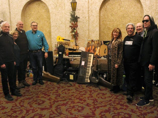 Sixty instruments were donated to children in need during the Todd Rundgren concert Wednesday, Dec. 13, 2017, in Sheboygan. Pictured, from left: Michael Houser, CEO of Cascio Music; Jean Lachowicz, executive director of Spirit of Harmony Foundation; Jeff Campbell; Terry Shircel, co-managing director of the Sheboygan Public Education Foundation; Michelle Rundgren; Ed Vigdor, chair of the Spirit of Harmony Foundation; Larry Samet, Kiwanis Club of Greater Sheboygan; Todd Rundgren.