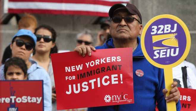 Local residents joined union 32BJ SEIU during a May Day Rally for Immigrant Rights in White Plains May 1, 2017.  Thousands of people across the country hit the street Monday to fight for fair work accommodations and stand up for immigrant families this May Day.