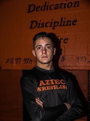 Aztec wrestler Austin Littlefield hopes to claim the state title this year after finishing in second place a season ago.